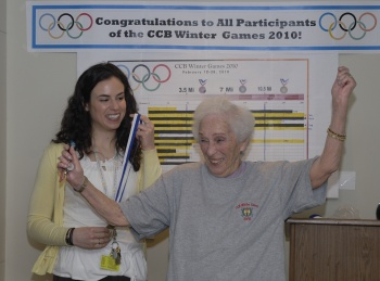 Woman receiving athletic medal - Photo by Mimi Katz